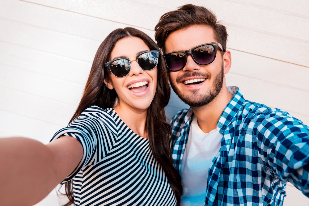 Two people in their 20's enjoying the UV protection that sunglasses from Hinsdale Eye Center can bring!